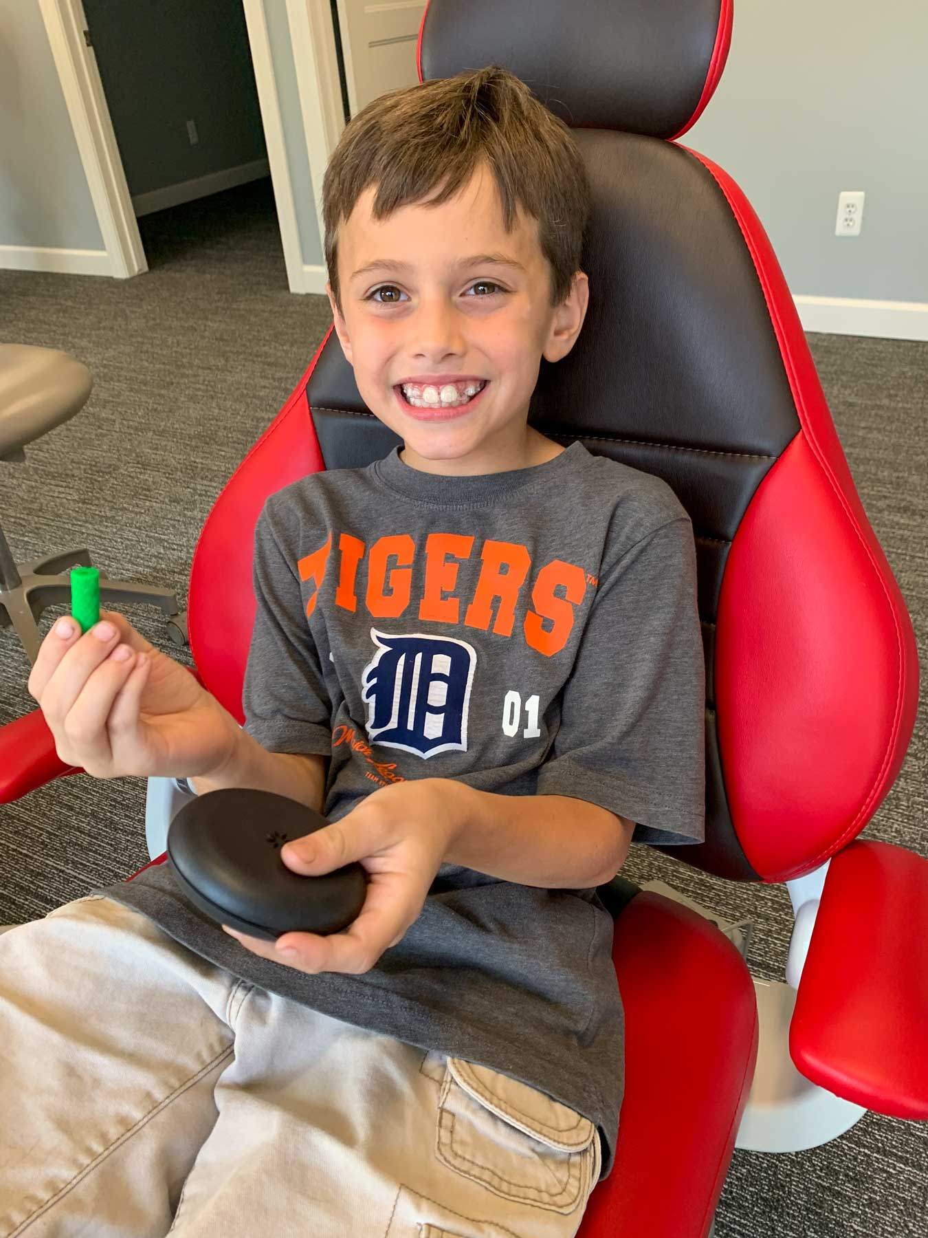 Little boy on orthodontist chair
